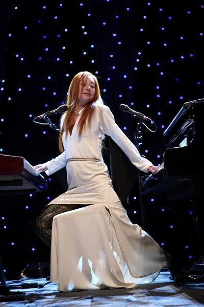Tori Amos; watching this tiny woman play a Baby Grand and a harpsichord at the same time is incredible.