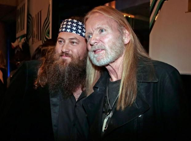 "Willie Robertson, left, of the TV show ""Duck Dynasty,"" and Gregg Allman arrive for the BMI Country Awards on Tuesday, Nov. 5, 2013, in Nashville, Tenn. (AP Photo/Mark Humphrey)"