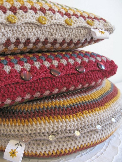 Lovely crochet pillows. Great ideas for button placement to open and remove for wash.