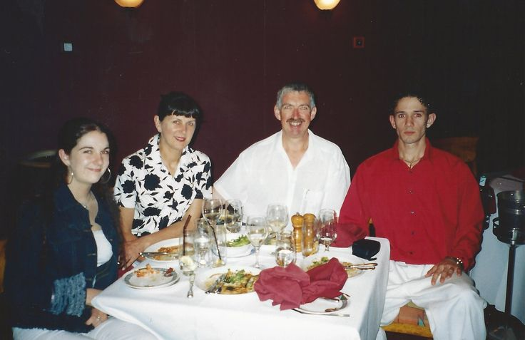 "I look like a deer in head lights. The waiter didn't say ""cheese"" before this photo while having a dinner with the family back in 2005."