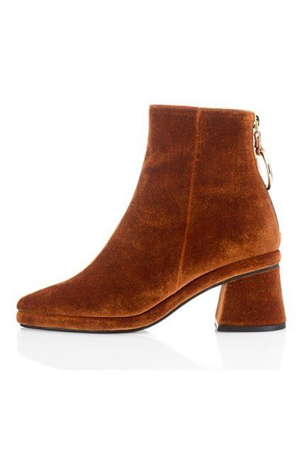 This burnt-orange color is a cool departure from your average black bootie.Reine Nen Ring Middle Boots, $298, available at W Concept. #refinery29 http://www.refinery29.com/best-womens-ankle-boots#slide-5