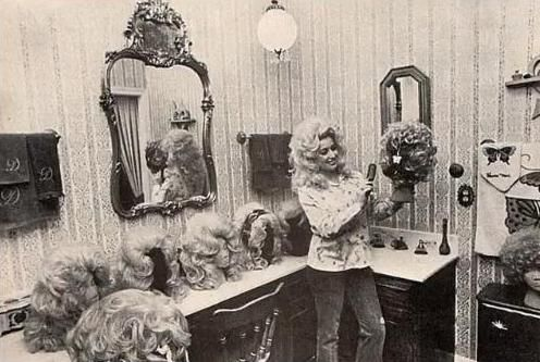 Dolly Parton, 1970s. Hanging out in her wig room. (via http://rookiemag.tumblr.com)