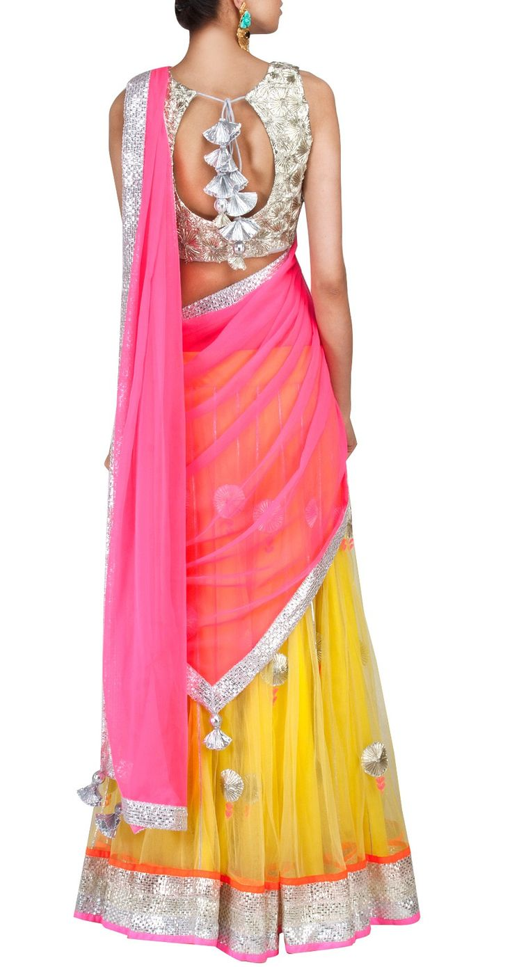 I think a Manish Malhotra. Yellow Lehenga with Gota. Mehendi and Sangeet Lehenga