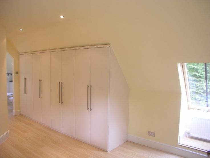 Angled storage for a loft conversion.  www.harmonymadetomeasure.co.uk