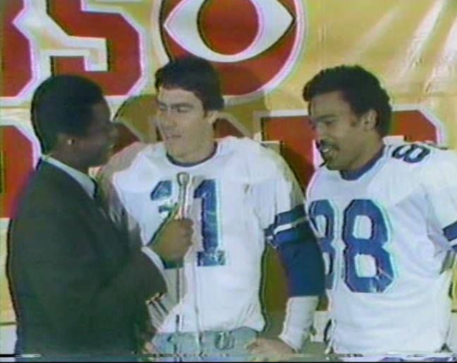 The NFL Today's Irv Cross interviews quarterback DANNY WHITE (11) and wide receiver DREW PEARSON (88) after the Cowboys' win over the Atlanta Falcons in the NFC Divisional Playoff on January 4, 1981.