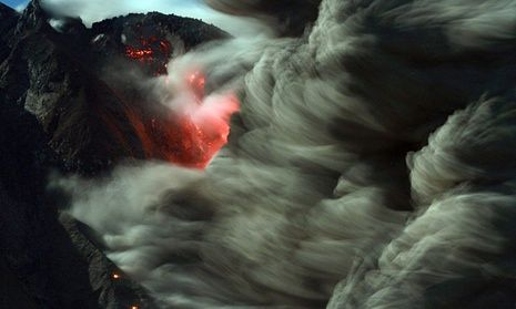 However spectacular volcanic eruptions in our time may be, they are unlikely to wipe out 90% of species. Mount Sinabung spews hot lava and volcanic ash in October 2014.