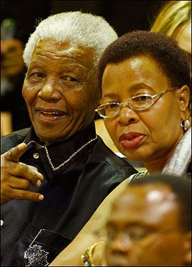 Happy ... Nelson Mandela with wife Graca . The world saw her continual love and support for the great man - I would have loved to have seen her flex her muscles a bit and put Winnie in the background and also to have stood up to that ANC photo shoot.