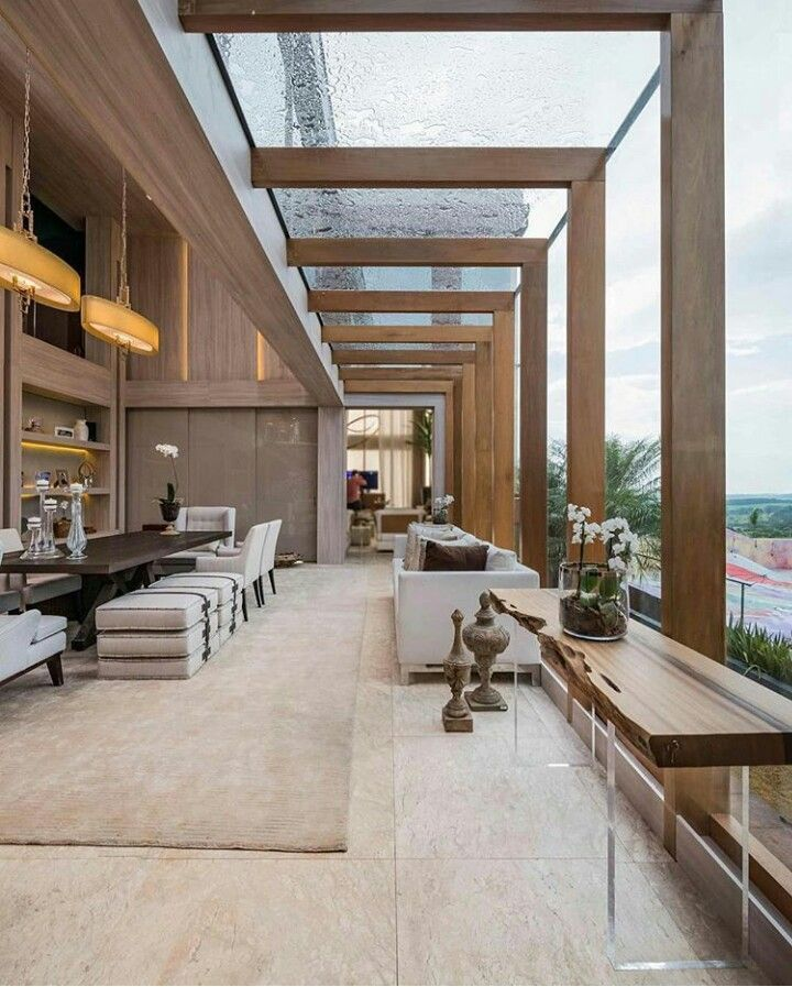 A beautiful architecture of this villa wood and glass high ceilings