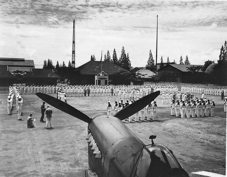 Morokrembangan, Soerabaja, Dutch East Indies 1948: Decoration ceremony with Mans Dorré and Joop de Haas being members of the Catalina PBY-5 Flying boat Y-45. Reason for their decoration was the rescue (21-3-1942) in two flights of 27 and 79 sailors from the bombed ships 'Sloet van de Beele' and the 'Van Nes'. A few days later, 27th of May, these Y-45 crew members spotted the Japanese invasion fleet. They immediately informed the ABDA-command. This leads to the 'Battle of the Java Sea'.