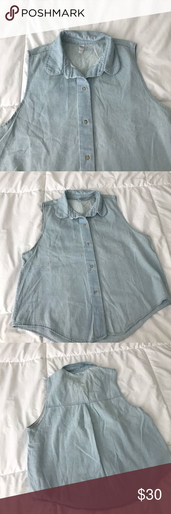 American Apparel sleeveless denim shirt American Apparle poplin denim sleeveless shirt. Button down top is somewhat cropped. Light weight comfortable denim, worn a few times and washed. Size M/L. Perfect for spring and summer or for layering! American Apparel Tops Button Down Shirts