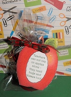 Teachers can not live on apples alone..... Fill bag with Hershey Hugs and Kisses.