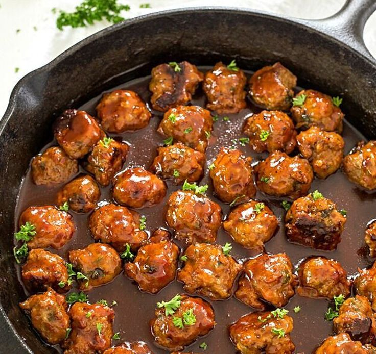 Easy Bacon Honey Bourbon Chicken Meatballs bake to perfection, and then simmer in an out-of-this-world honey bourbon barbecue sauce! Perfect as an appetizer or to serve on sandwiches.