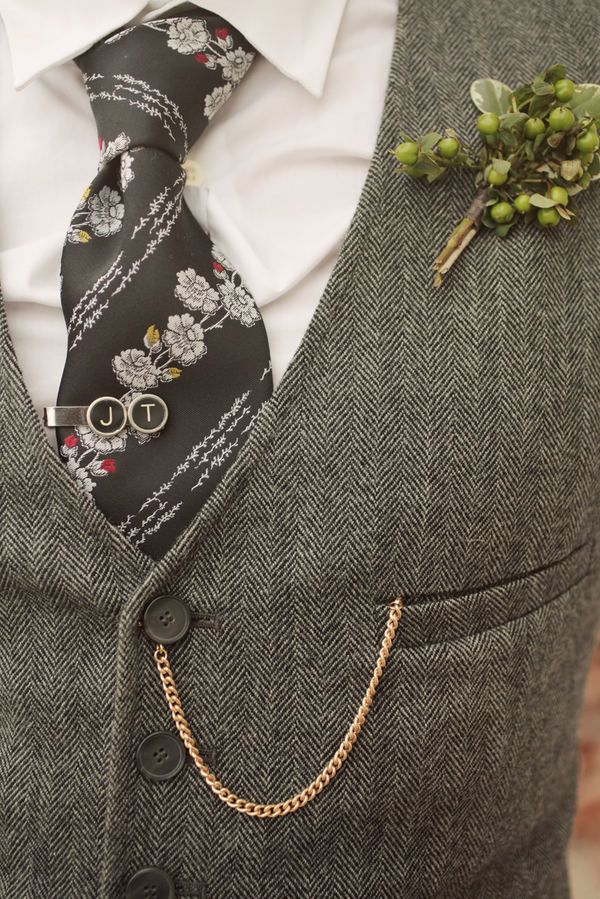 I love everything in this... the vest, tie, tie pin and boutonniere... I wish men dressed like this all the time. :-)