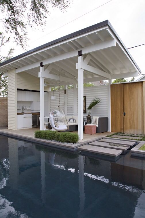 Pool Cabana and a relaxing area all in one. #outdoorliving #pool #cabana