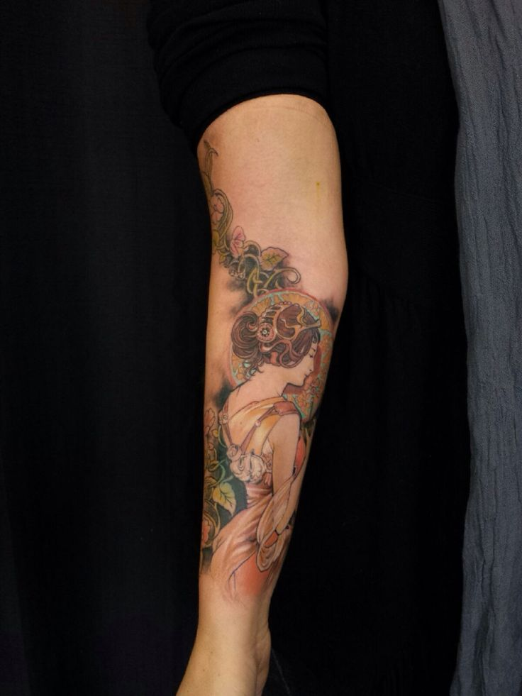Colorful lower arm tattoo.