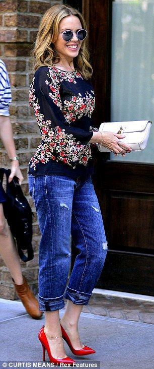 Flower power: Kylie wore shades to match the slightly #hippy vibe as she arrived at a downtown hotel