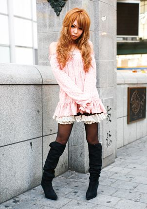 Cute, gyaru: Light pink blouse with frills. Black underskirt with white frills. Sheer black tights. Black boots with heels.