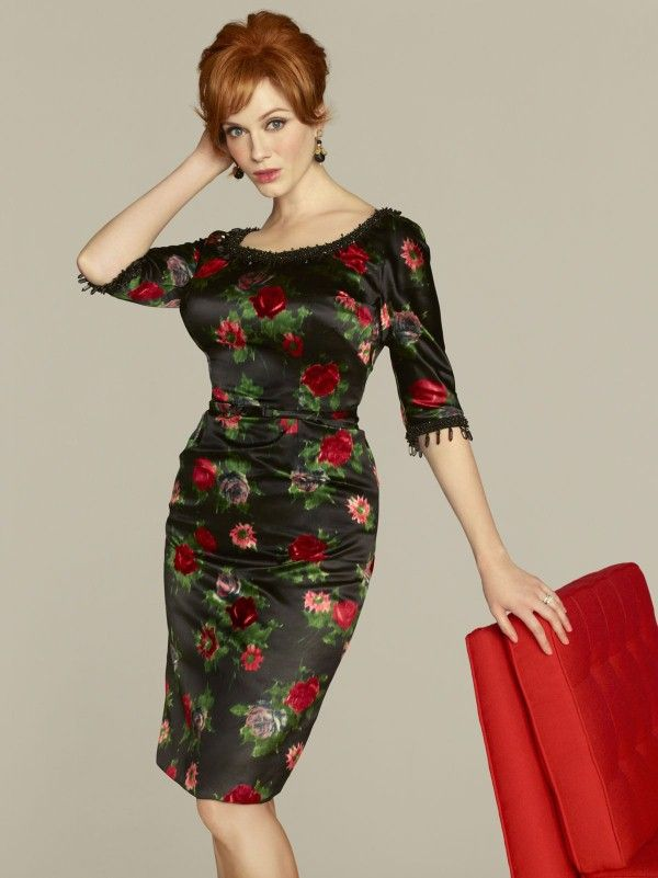 Here are 10 pics of CHRISTINA HENDRICKS at Mad Men Season 5 Promo Shoot. The hot actress is wearing a tight black dress with rose print.
