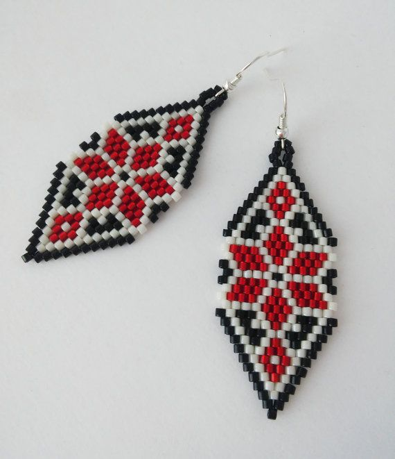 Ukrainian national pattern. Ethnic earrings with Ukrainian embroidery pattern Beautiful earrings from Japanese seed beads in the shape of a