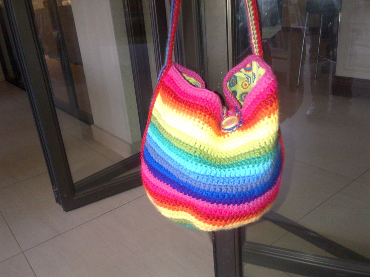 A very colourfull bag that I made for a gift ! Looks like a rainbow, lined inside and fastens with a button !