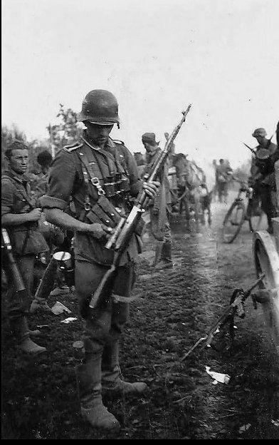 """kruegerwaffen: """" German soldier with captured Soviet sniper rifle SVT-40. """""""