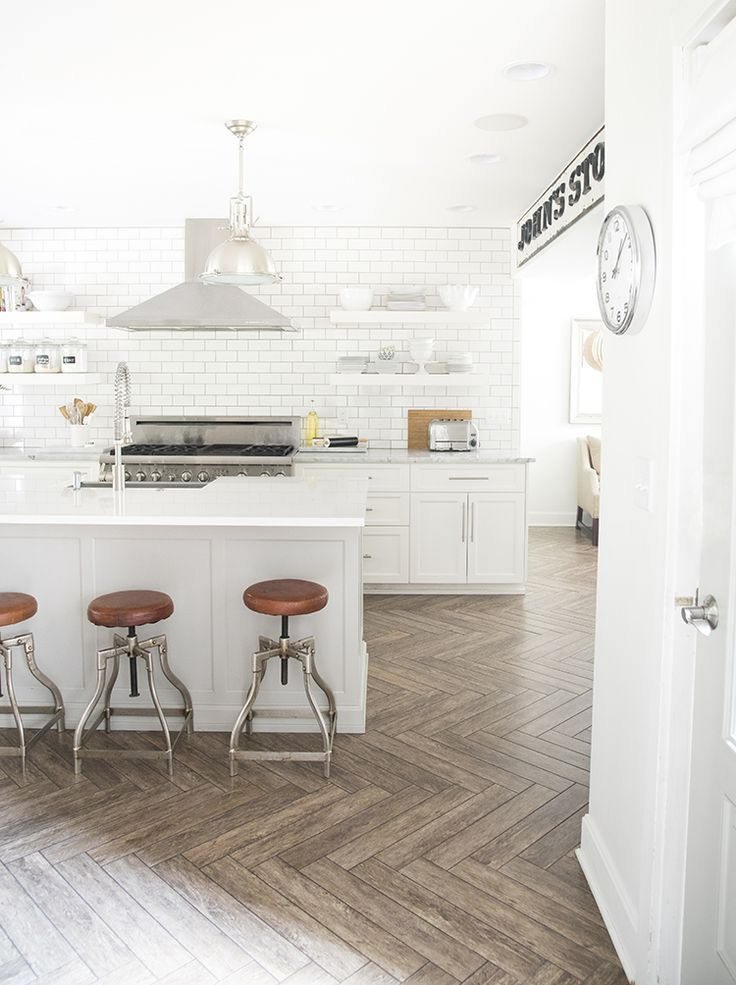A Bright White Family Friendly Kitchen - the flooring is wood look tile
