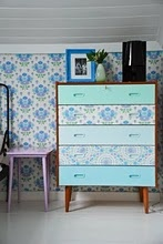 this is ugly...but the idea is good...wallpaper on furniture