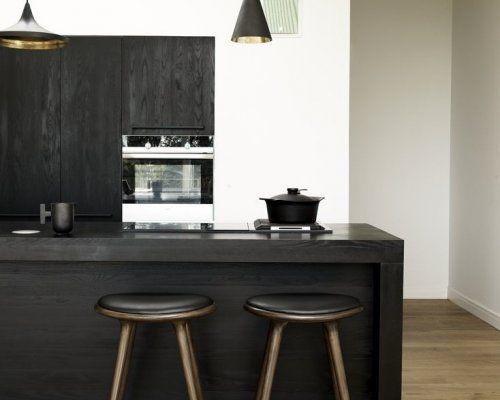 black kitchen. love the wood grain