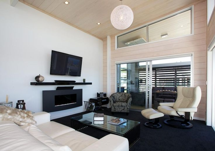 Light and bright living room area with wood and gib walls creates a clean but warm atmosphere.