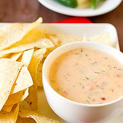 A recipe for Chile con Queso, sometimes referred to as Queso Dip - Creamy cheese blended together with chiles and tomatoes.