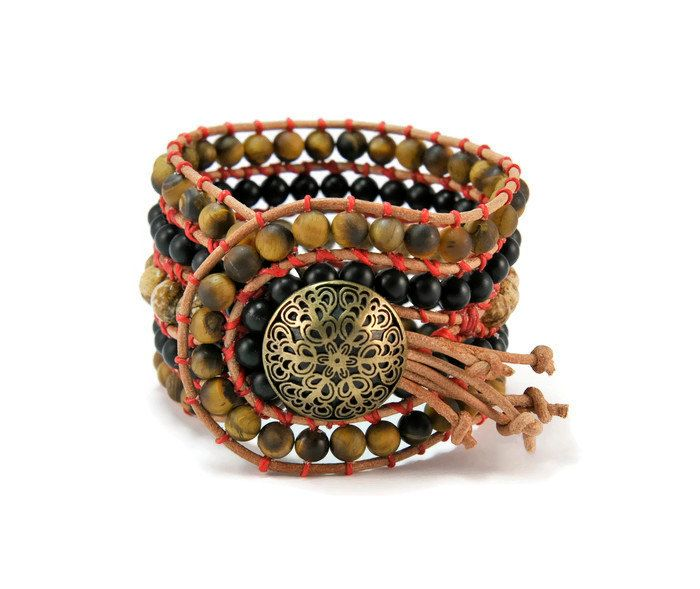 A bohemian trend bracelet !!! Semi precious stones of Jasper, mat onyx & mat tiger eye are framed by brown leather woven together with red wax cotton cord. This eye catching design also features a bronze metal, repousse, lightly oxidized closure.This bohemian style bracelet upgrades your casual look.