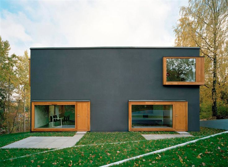 Gray Plaster with Oak Boxes Double house by Tham & Videgård