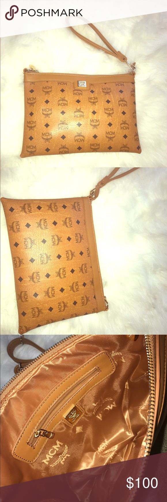 MCM WRISTLET ** HOT SELLER**price cut today only MCM clutch cognac color great condition comes with bag MCM Bags Clutches & Wristlets