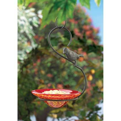 Expect happy guests to fly in for the feast served in this lovely hand-blown glass bowl feeder. Striking perfect harmony between the strength of the metal framework and the delicate beauty of the red and yellow glass serving dish, this feeder's molded metal bird motif will encourage all of your f...