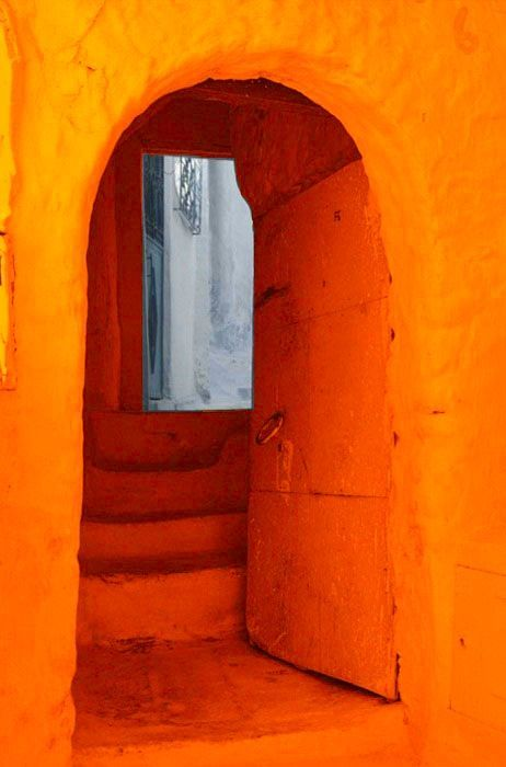 This orange doorway marks the beginning of a joyful journey.