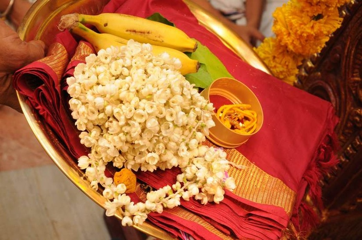 """The Maangalyam: It is tied around the bride's neck in three knots -symbolizingmarriage of the mind,spirit and body. The groom recites this verse thrice: """"Maangalya thanthunaanena mama jeevana hethunaa; Kante: badhnaami subhage tvam jeeva saradhah satham"""".  Meaning: """"This is a sacred thread. It is essential for my long life. I tie this around yourneck, O Maiden with many auspicious attributes! May you live happily for a hundredyears with me!"""""""