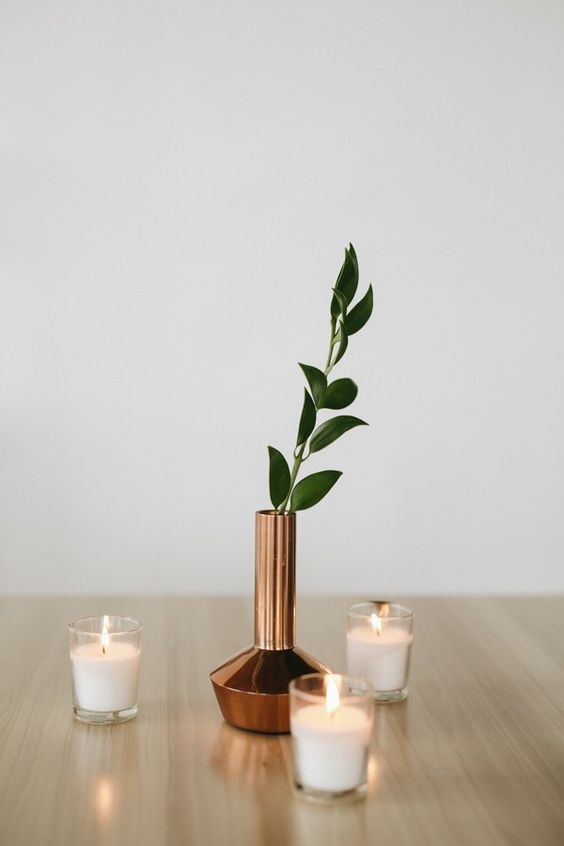 41 Edgy Modern Wedding Ideas You'll Love: candles and a copper vase with leaves for a modern centerpiece