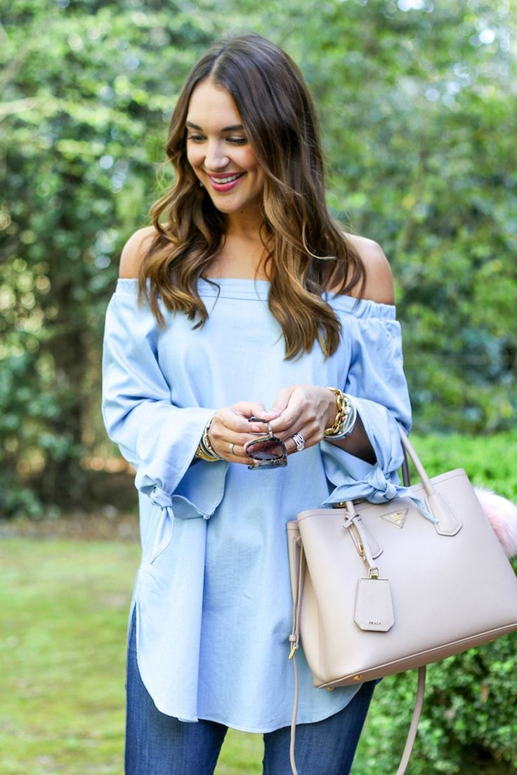 Dress it up, dress it down. This comfortable, loose off-the-shoulder top looks just as cute with long boyfriend shorts or white jeans as it does with regular denim. Sleeves tie at the wrists and side