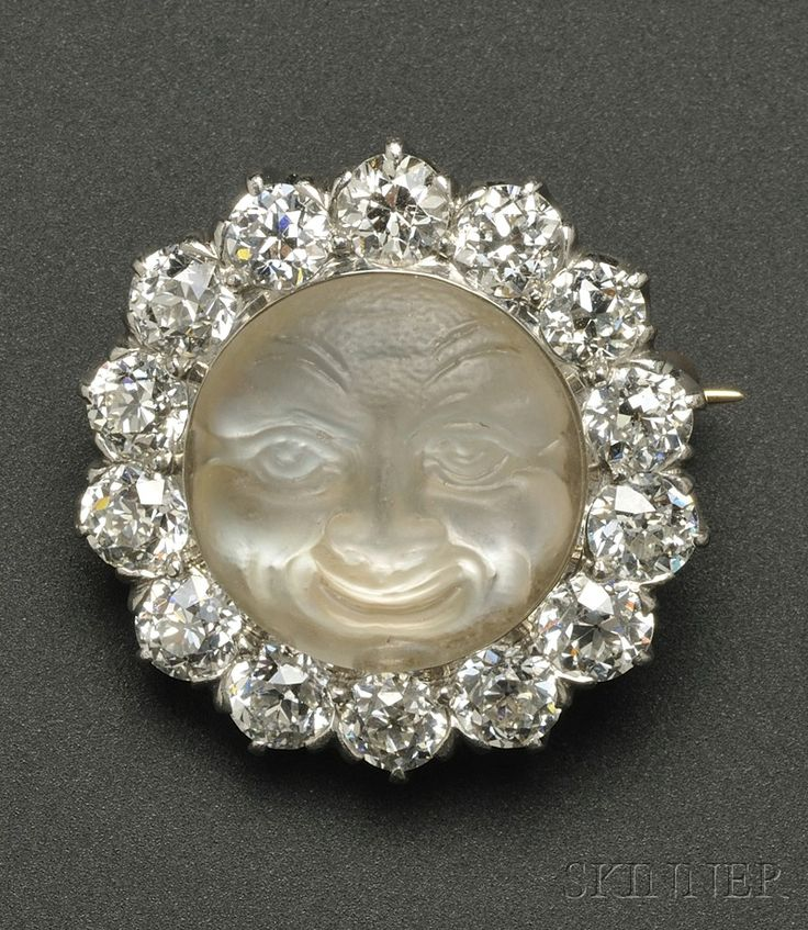 Carved moonstone-and-diamond brooch, by Tiffany & Co, depicting the man in the moon.