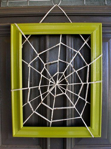 Grab an empty frame, yarn, and some tape to make this cute door hanging.