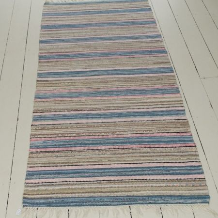 A beautiful rug in perfect condition. Soft clear colours. 100% Cotton. Dry cleaning recommended.
