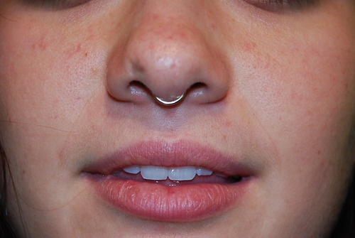 Oddly, I have begun to love tiny septum piercings. Hmm..