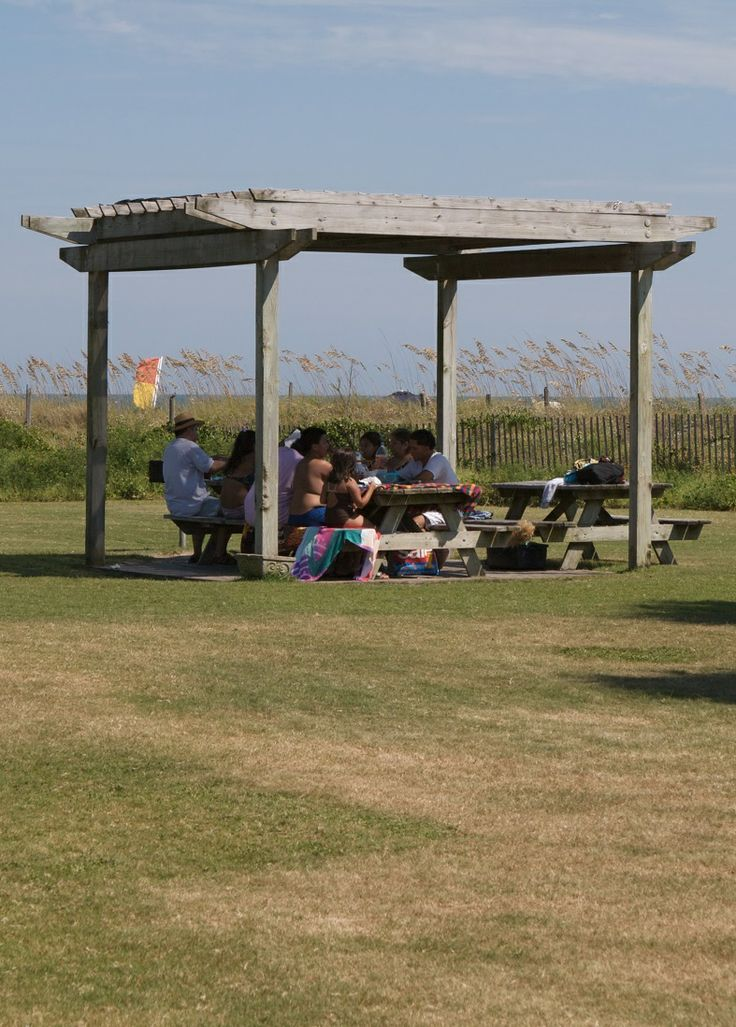 A family takes a break from the beach to enjoy a meal at the Isle of Palms County Park picnic area. (IOP, South Carolina)