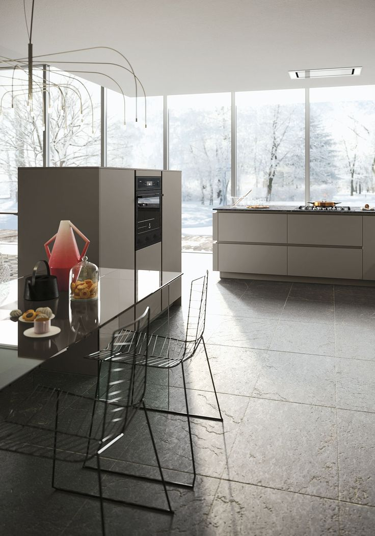 Snaidero LOOK kitchen's handle-less cabinet doors, recessed finger pulls and  combination of volumes and  materials create a unique, tailor-made style. #SnaideroUSA | Michele Marcon Design
