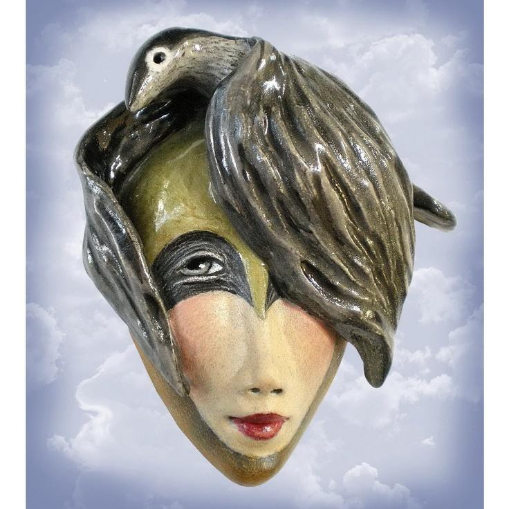 Birdgirl's Adventure - Ceramic mask pendant. Peggy Bjerkan, via Etsy.