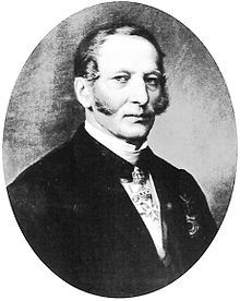 August Ludwig Freiherr von Senarclens de Grancy (19/8/1794 – 3/9/1871) was born Auguste Louis de Senarclens de Grancy at the Château d'Etoy in the canton of Vaud, Switzerland. He became Grand Master of Stables of the Grand Duke of Hesse, Major General and Knight of Honor and Devotion in the Order of Malta. It is rumored that he was the biological father of the youngest four children of his employer's wife Wilhelmine of Baden.
