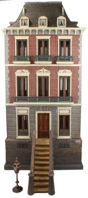 """Spanish Second Empire doll's house with 1888 date and maker's name """"Pintor Rafael"""" on back of façade. Magnificently restored, pictured in 1980 book Dollhouses Past and Present. Three-story townhouse features quoining and mansard roof simulating slate, estimate $10,000 to $15,000. -"""