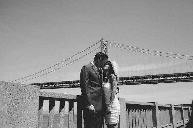 San Francisco Bridge. Wedding portrait. Bride and groom kissing. Tattooed Bride. Tattooed Groom. Copyright Bri McDaniel