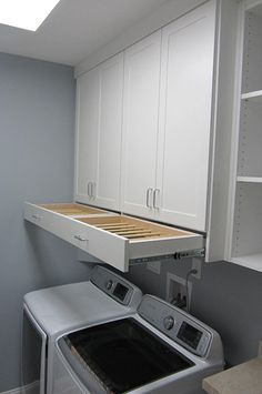 OMG! I love that drying rack drawer!! Laundry Room Cabinet Ideas   Get Laundry Room Solutions Closet Factory