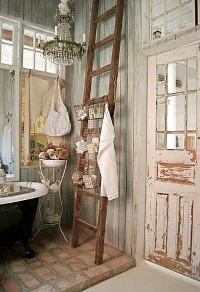 rustic chic bathroom. Love the wire baskets on the old ladder for storage.